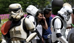 "Cosplayers dressed up as ""Star Wars"" characters Storm Troopers and Scout Trooper take part in a Star Wars Day fan event in Tokyo"