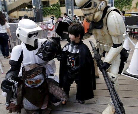 "Cosplayers dressed up as ""Star Wars"" characters Scout Trooper, Storm Trooper and Darth Vader take part in a Star Wars Day fan event in Tokyo"