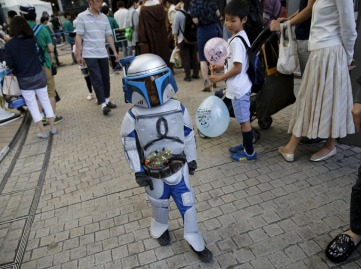 "Cosplayer dressed up as ""Star Wars"" character Jango Fett walks at a Star Wars Day fan event in Tokyo"
