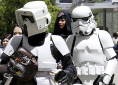 "Cosplayers dressed up as ""Star Wars"" characters Scout Trooper and Storm Trooper take part in a Star Wars Day fan event in Tokyo"